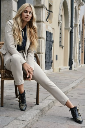 Navy jacket in sandy beige color